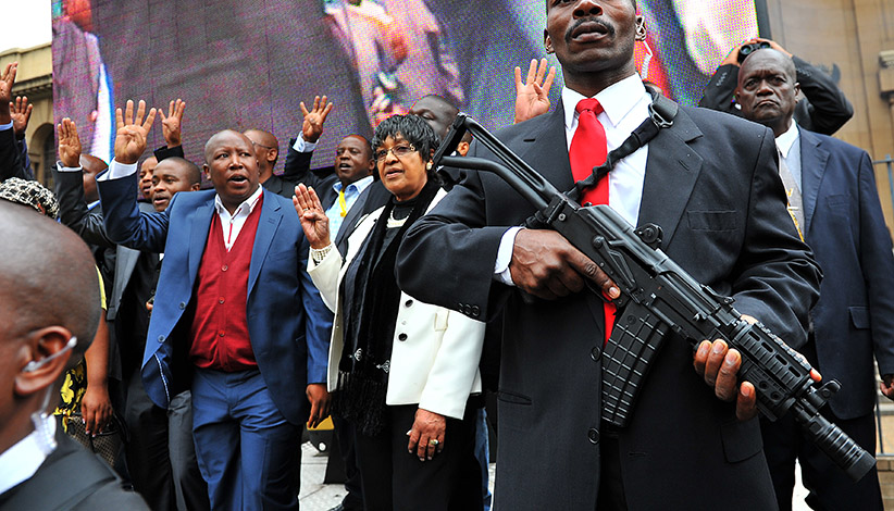 Julius Malema (left, with a blue suit) and Winnie Madikizela-Mandela. (Alexander Joe/AFP/Getty Images)
