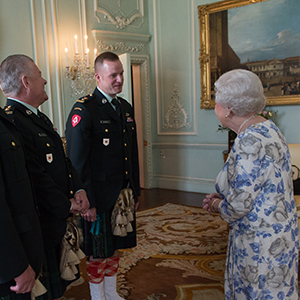 Queen Elizabeth II, in her capacity as Colonel-in-Chief of the Argyll and Sutherland Highlanders of Canada, receives (from left) Colonel Ronald Foxcroft (Honorary Colonel), Lieutenant Richard Kennedy (Honorary Lieutenant Colonel) and Lieutenant Colonel Lawrence Hatfield (Commanding Officer) at Buckingham Palace in London. Stefan Rousseau/PA