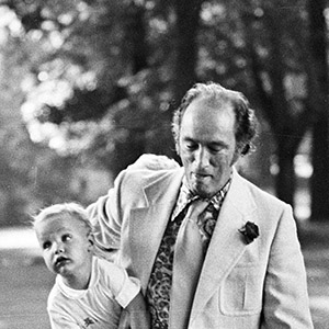 Pierre Trudeau is saluted by RCMP Officer as he carries son Justin to Rideau Hall in 1973 to attend an outdoor reception for visiting heads of the Commonwealth countries in Ottawa.(Peter Bregg/CP)