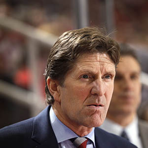 Detroit Red Wings head coach Mike Babcock watches the second period of an NHL hockey game against the New Jersey Devils in Detroit, Friday, Nov. 7, 2014. (Paul Sancya/AP)