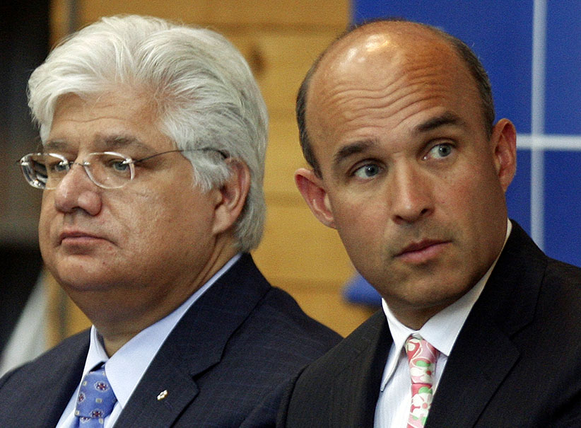 In this photo from 2009, Research in Motion co-CEO Jim Balsillie (right) and President and co-CEO Mike Lazaridis listen during the annual general meeting of shareholders in Waterloo, Ontario. (Mike Cassese/Reuters)