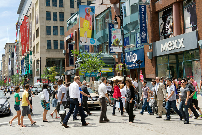 Pedestrians crossing the street at Saint Catherine Street in Montreal. (Pierre Rochon/Alamy)