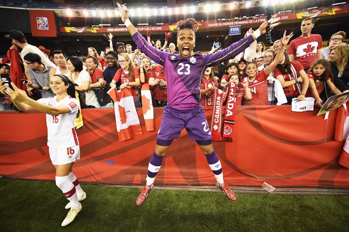 Canadian goalie Karina LeBlanc celebrates with fans at the end of the FIFA Women's World Cup Group A match between Netherlands and Canada at Olympic Stadium in Montreal (Stuart Franklin/FIFA/Getty Images)