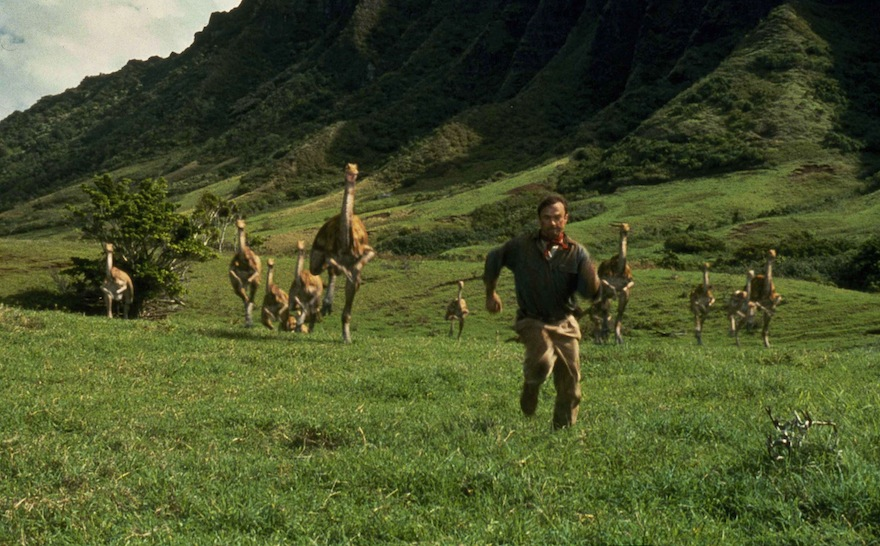 "Sam Neill, portraying Dr. Alan Grant, runs from dinosaurs in a scene from ""Jurassic Park, in this 1993 file image originally released by Universal Pictures, THE CANADIAN PRESS/AP Photo/Universal Pictures"