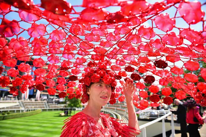 Racegoer Larisa Katz attends Ladies' Day at the Royal Ascot racecourse in Ascot, England. The horserace runs until June 20, and has taken place since 1711. (Jeff J Mitchell/Getty Images)