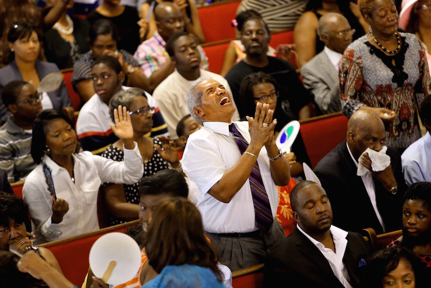 Jimmy Guyton participates in a worship service at Emanuel A.M.E. Church, Sunday, June 21, 2015, in Charleston, S.C., four days after a mass shooting at the church claimed the lives of its pastor and eight others. (Paul Zoeller/The Post And Courier via AP)