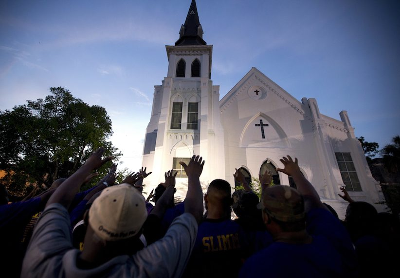 The men of Omega Psi Phi Fraternity Inc. lead a crowd in prayer after a memorial in Charleston, S.C. (Stephen B. Morton, AP )