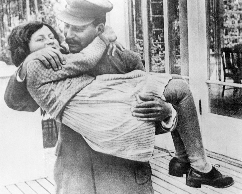 A rare photo of Marshal Josef Stalin holding his daughter, Svetlana. The photo was taken in 1937, at Stalin's country house in the suburbs of Moscow. (Bettmann/CORBIS)