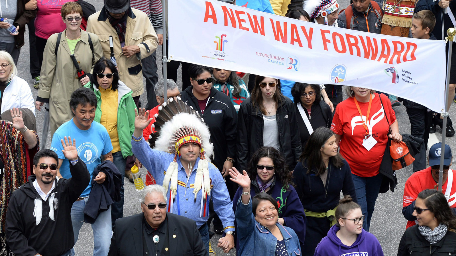 Assembly of First Nations Chief Perry Bellegarde (in headdress) and Justice Murray Sinclair (in black suit), TRC commissioner, march during the Walk for Reconciliation, part of the closing events of the Truth and Reconciliation Commission on Sunday, May 31, 2015 in Gatineau, Que. Beginning in the 1870s, over 150,000 First Nations, Metis and Inuit children were required to attend government-funded, church-run residential schools in an attempt to assimilate them into Canadian society; the last school closed in 1996. Students were prohibited from speaking their own languages, practicing their culture and often experienced physical and sexual abuse. Justin Tang/CP