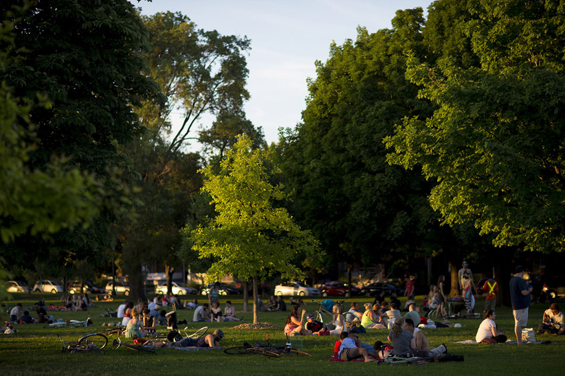 TORONTO, ON - JULY 1  - People gather early in the evening at Trinity Bellwoods Park to watch fireworks on Canada Day. July 1, 2014. Carlos Osorio/Toronto Star/Getty Images