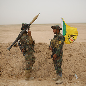 fighters of Kataeb Hizbullah of Popular Mobilization stand on guard in the Desert  near Ankur village east of Anbar province on May 28, 2015 in Anbar, Iraq   (Ahmad Mousa/The Washington Post/Getty Images)