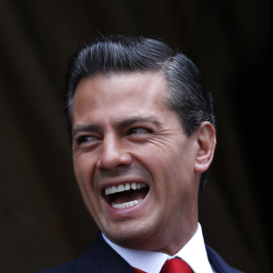 Mexico's President Enrique Pena Nieto smiles during a military parade celebrating Independence Day at Zocalo Square in downtown Mexico City, September 16, 2014.  Edgard Garrido/Reuters