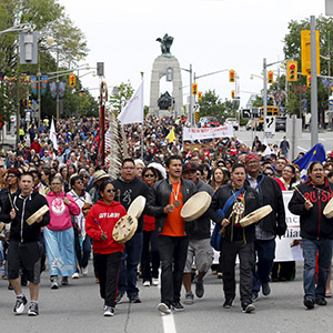 Drummers lead the Walk for Reconciliation in Ottawa May 31, 2015. The event is one of many surrounding the release of the final report from the Truth and Reconciliation Commission on the former Canadian Indian residential school system, which will be released June 2. (Chris Wattie/Reuters)