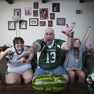 CFL super fan Matt Lalor (centre) and family watching a game in their Alton, Illinois home. (Photograph by Dusty Kessler)