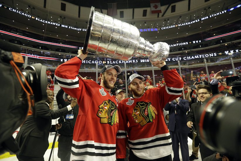 Chicago Blackhawks center Jonathan Toews and Chicago Blackhawks right wing Patrick Kane celebrate after defeating the Tampa Bay Lightning in Game 6 of the NHL hockey Stanley Cup Final series on Monday, June 15, 2015, in Chicago. The Blackhawks defeated the Lightning 2-0 to win the series 4-2. (AP Photo/Nam Y. Huh)