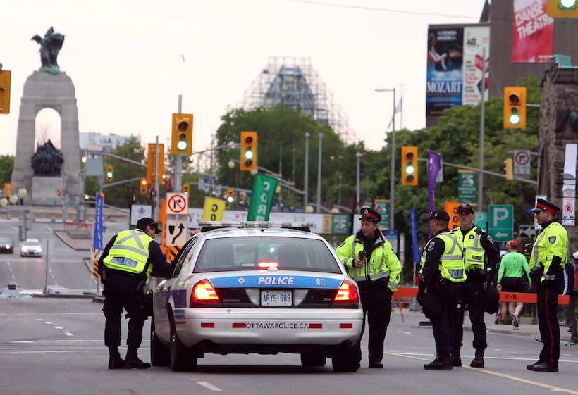 Ottawa police patrol the streets during the Ottawa Marathon, in Ottawa, Sunday May 26, 2013. (Fred Chartrand/CP)