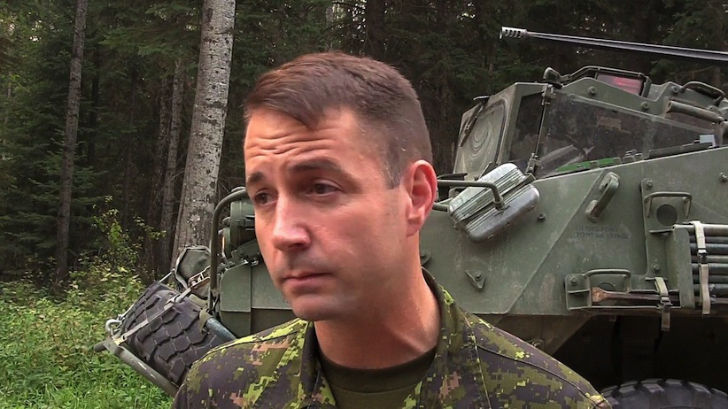 In this screengrab from video, Lt.-Col. Mason Stalker is interviewed as Canadian troops fight fires in Montreal Lake, Sask., Thursday, July 9, 2015. A high-ranking Canadian Forces officer faces serious, sex-related charges involving allegations that stem from the mentoring of military cadets. (Bill Graveland/CP)