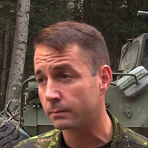 In this screengrab from video, Lt.-Col. Mason Stalker is interviewed as Canadian troops fight fires in Montreal Lake, Sask., Thursday, July 9, 2015. A high-ranking Canadian Forces officer faces serious, sex-related charges involving allegations that stem from the mentoring of military cadets. THE CANADIAN PRESS/Bill Graveland