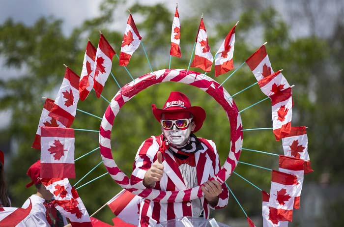 A character on a float gives a thumbs-up along the Canada Day Parade route through Port Credit in Mississauga, Ont. on Wednesday, July 1, 2015. (Peter Power/CP)