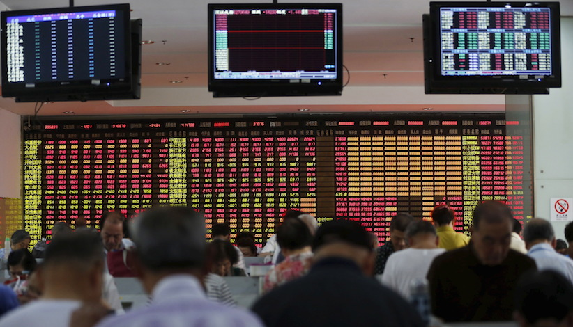 Investors look at computer screens in front of an electronic board showing stock information at a brokerage house in Shanghai, China, July 14, 2015. Asian shares and the euro were tentatively higher on Tuesday on hopes that Greece's conditional bailout agreement would bring to an end that country's debt crisis, though caution kept broad gains in check. REUTERS/Aly Song - RTX1K9IM