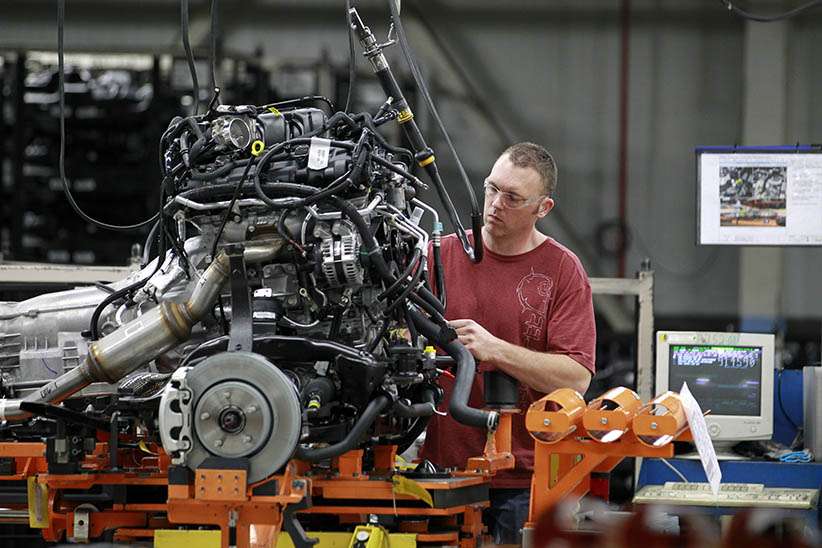 A Chrysler Group LLC employee inspects an engine on the production line of the company's Jefferson North Assembly Plant in Detroit, Michigan, U.S., on Thursday, April 28, 2011. Chrysler Group LLC, the automaker run by Fiat SpA, plans to repay $7.53 billion in loans from U.S. and Canadian governments this quarter as it moves toward an initial public offering and merger with its Italian partner. ( Jeff Kowalsky/Bloomberg/Getty Images)