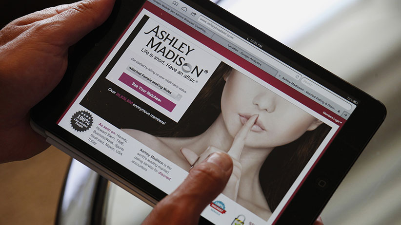 Ashley Madison founder Noel Biderman demonstrates his website on a tablet computer during an interview in Hong Kong August 28, 2013. Founded in 2002, Ashley Madison, the world's biggest online dating website for married men and women, has over 20 million users in 30 regions all over the world. (Bobby Yip/REUTERS)