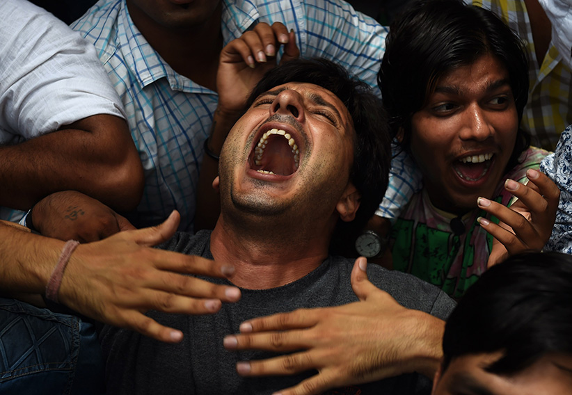 Anguish: Indian activists protest a deadly attack by suspected terrorists from Pakistan on a police station in the Punjabi district of Gurdaspur (Sajjad Hussain/AFP/Getty Images)