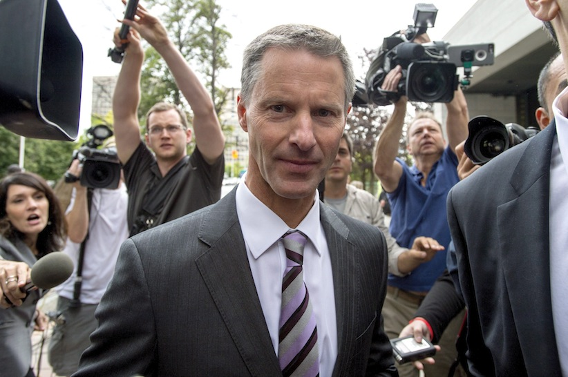 Nigel Wright, former chief of staff to Prime Minister Stephen Harper, makes his way through a crush of media as he arrives to testify at the criminal trial of embattled Sen. Mike Duffy in Ottawa Wednesday, August 12, 2015. THE CANADIAN PRESS/Justin Tang