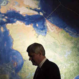 Prime Minister Stephen Harper is silhouetted against a map of Northern Canada during a reception commemorating the Franklin Expedition at the Royal Ontario Museum in Toronto on Wednesday, March 4, 2015. (Darren Calabrese/CP)