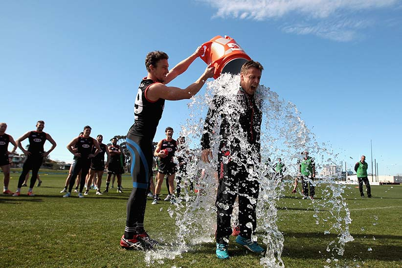 MELBOURNE, AUSTRALIA - AUGUST 22:  Coach Mark Thompson undertakes the 'Ice Bucket Challenge' during an Essendon Bombers AFL training session at True Value Solar Centre on August 22, 2014 in Melbourne, Australia.  (Photo by Robert Prezioso/Getty Images)