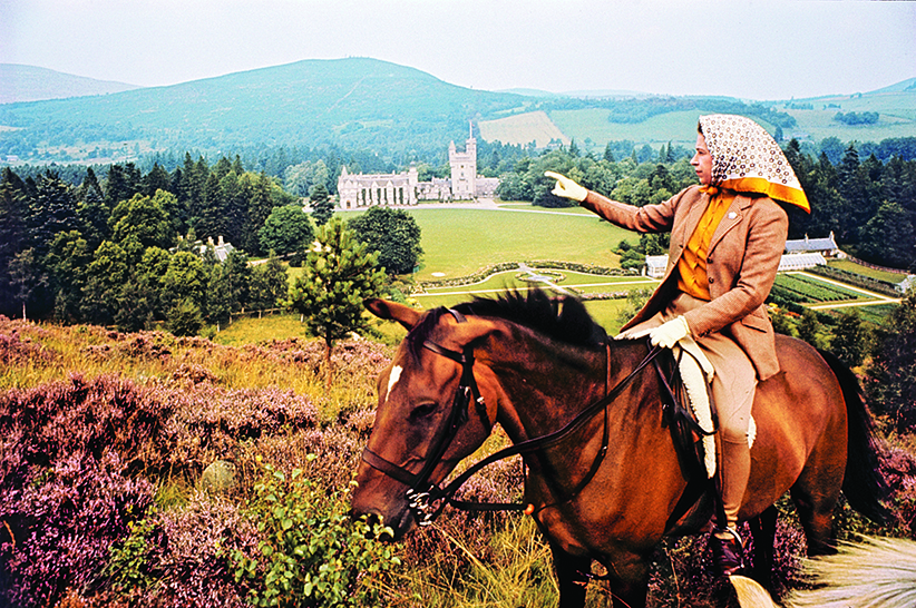 The Queen on horseback looking towards Balmoral Castle, Scotland in the distance during the Royal Family's annual summer holiday in September 1971.  Part of a series of photographs taken for use during the Silver Wedding Celebrations in 1972. (Lichfield/Getty Images)