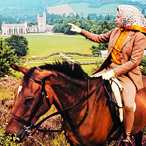 HM The Queen on horseback looking towards Balmoral Castle, Scotland in the distance during the Royal Family's annual summer holiday in September 1971.  Part of a series of photographs taken for use during the Silver Wedding Celebrations in 1972. Lichfield/Getty Images.