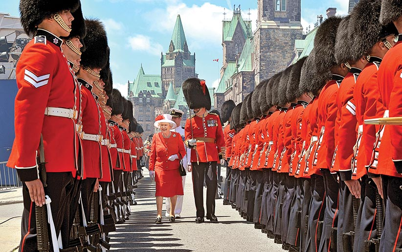 Queen Elizabeth II inspects a Guard of Honour outside the Canadian Parliament, after arriving to attend the Canada Day celebrations on July 1, 2010 in Ottawa, Canada. (John Stillwell/Getty Images)