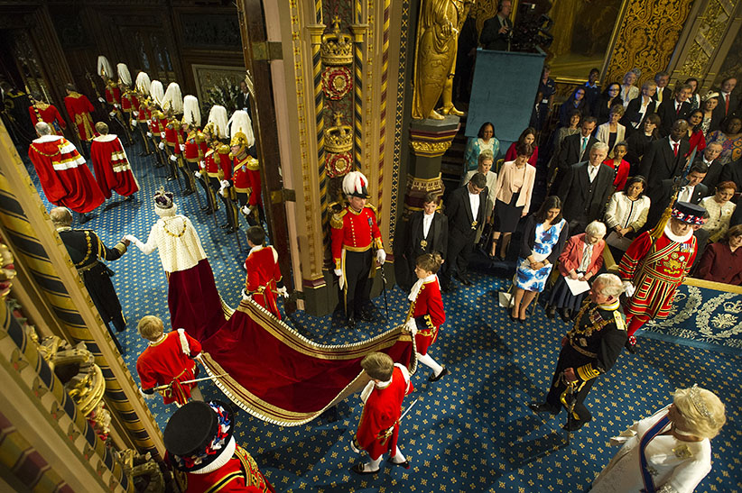 Queen Elizabeth II  is accompanied by Prince Philip, Duke of Edinburgh, followed by Prince Charles and his wife Camilla, Duchess of Cornwall, pass through the Royal Gallery during the State Opening of Parliament in the House of Lords, at the Palace of Westminster on May 27, 2015 in London, England. (Geoff Pugh/WPA/Getty Images)
