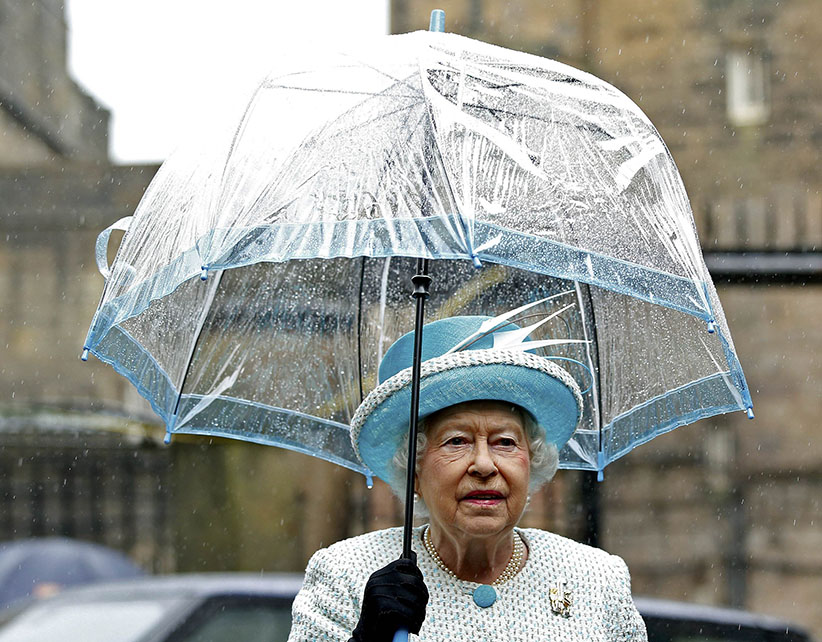 Queen Elizabeth II holds an umbrella as she visits Lancaster Castle on May 29, 2015 in Lancaster, England. (Andew Yates/Getty Images)