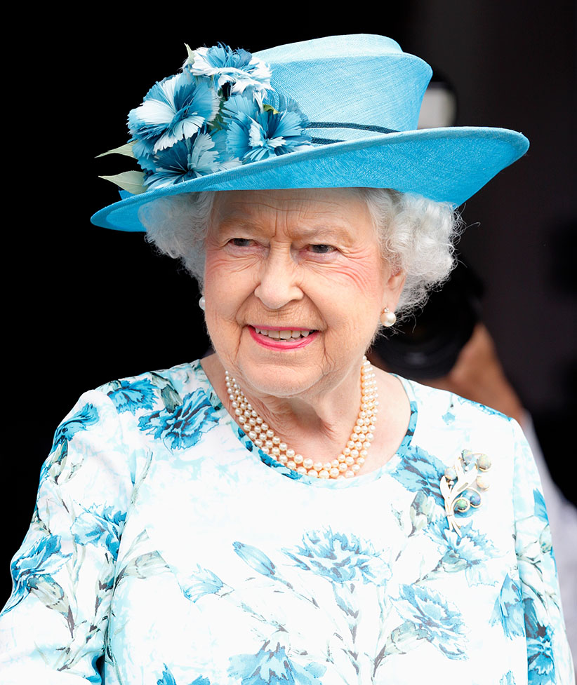 BARKING, UNITED KINGDOM - JULY 16: (EMBARGOED FOR PUBLICATION IN UK NEWSPAPERS UNTIL 48 HOURS AFTER CREATE DATE AND TIME) Queen Elizabeth II stands the balcony of the Broadway Theatre during a day of engagements in the London Borough of Barking and Dagenham on July 16, 2015 in Barking, England. Max Mumby/Indigo/Getty Images