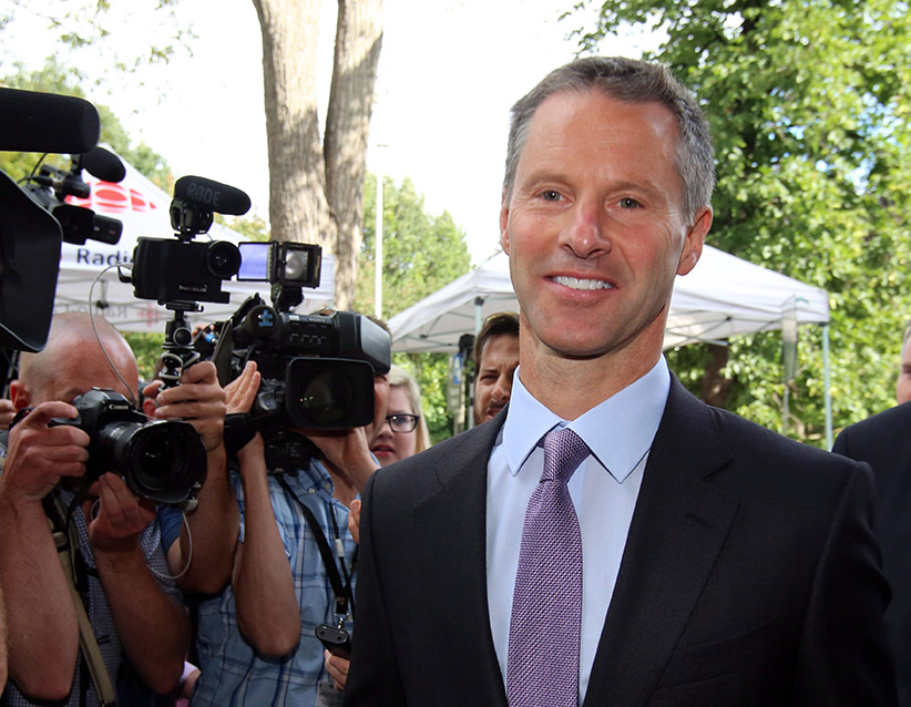 Nigel Wright, former chief of staff to Prime Minister Stephen Harper, arrives at the courthouse in Ottawa on Thursday, Aug. 13, 2015 for his second day of testimony at the criminal trial of embattled Sen. Mike Duffy. (Fred Chartrand/CP)