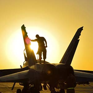 Royal Canadian Air Force ground crew perform post flight checks on a CF-18 fighter jet in Kuwait after a sortie over Iraq during Operation IMPACT on November 3, 2014.
