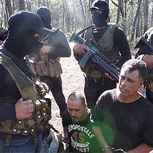 Members of the Jalisco New Generation cartel (CJNG) record themselves with prisoners from a rival cartel.  YouTube
