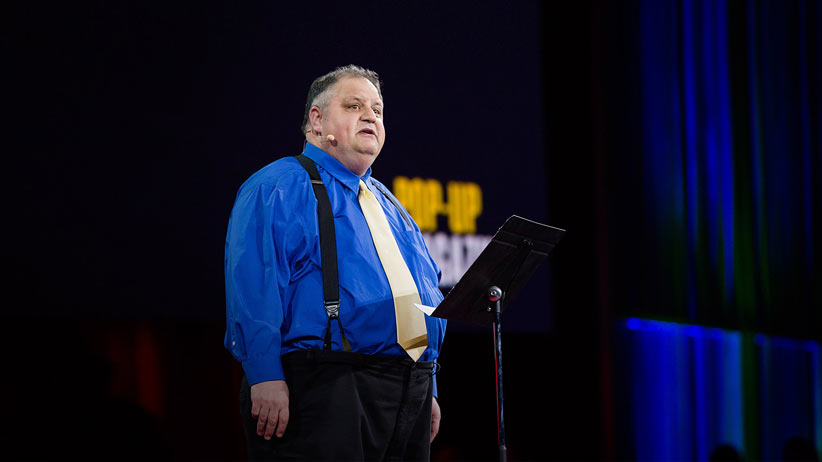 Steve Silberman delivers a speech at a Ted Talk. (YouTube)