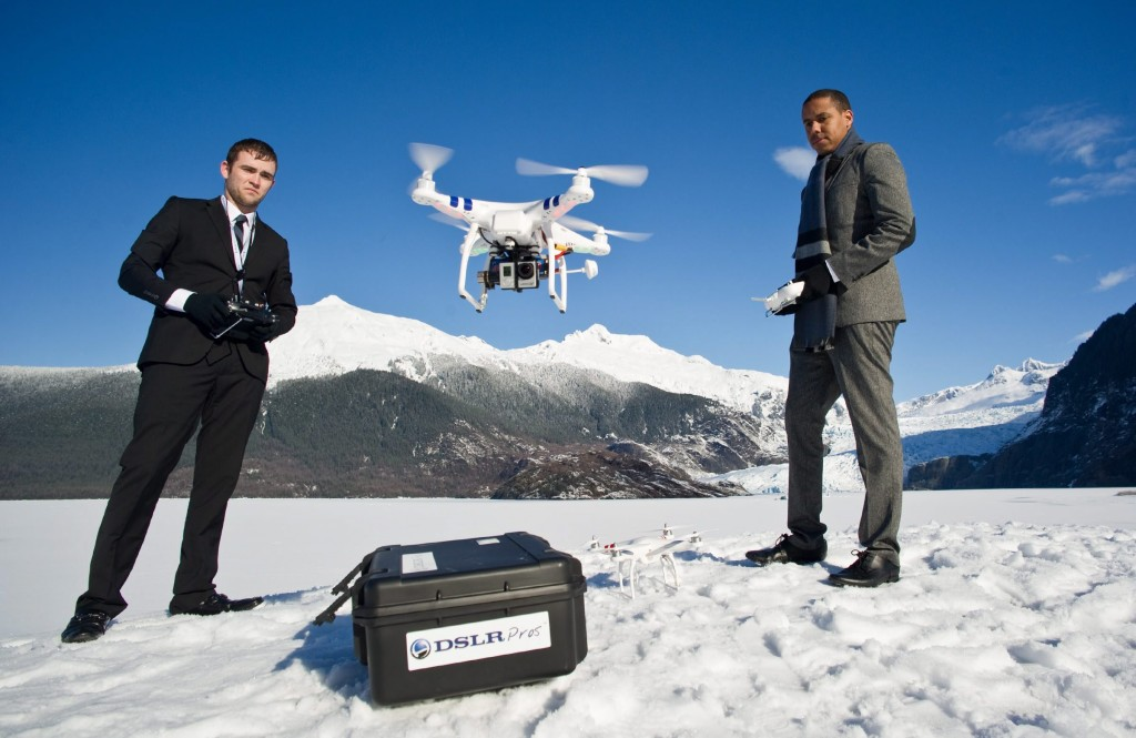 Chris Carson, left, and Lion El Aton of Firefight Films demonstrate their DJI Phantom drone quadcopter at Mendenhall Lake in Juneau, Alaska, on Thursday, March 20, 2014. They have been using the unit to film the glacier and an ice cave this winter. (AP Photo/Juneau Empire, Michael Penn)