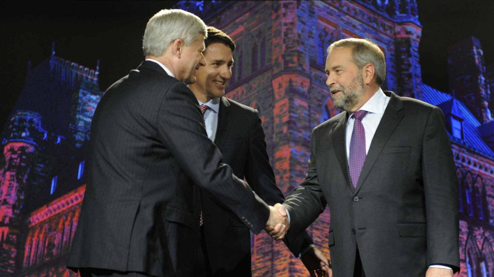 Conservative leader Stephen Harper (L), greets NDP leader Thomas Mulcair (R) as Liberal leader Justin Trudeau looks on prior to the beginning of  the Globe and Mail Leaders Debate in Calgary, Alberta September 17, 2015. (MIKE STURK/Reuters)