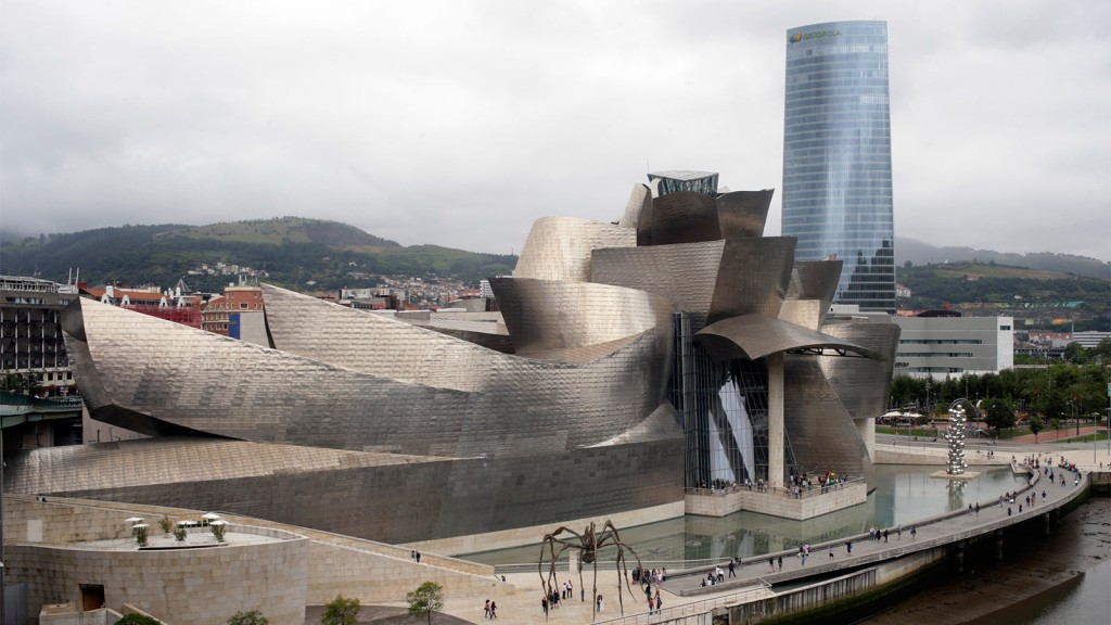 The headquarters of Iberdrola SA stands beyond the Guggenheim Museum in Bilbao, Spain, on Tuesday, Aug. 4., 2015. Iberdrola SA, Spain's largest utility, agreed to sell power from a 132-megawatt wind farm to Edison International's Southern California Edison utility unit. Pau Barrena/Bloomberg/Getty Images