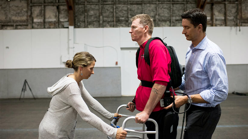 Trevor Greene learning to use the reWalk exoskeleton in Nanaimo, BC on August 5, 2015. Photograph by Jimmy Jeong