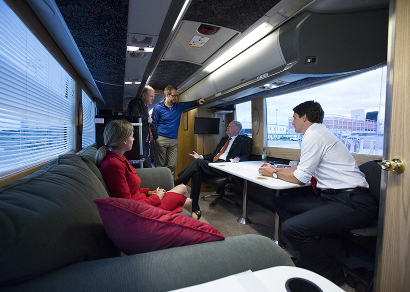 Justin Trudeau with Gerald Butts and others on the road during 2015 Federal election campaign. (Adam Scotti/Liberal Party of Canada)