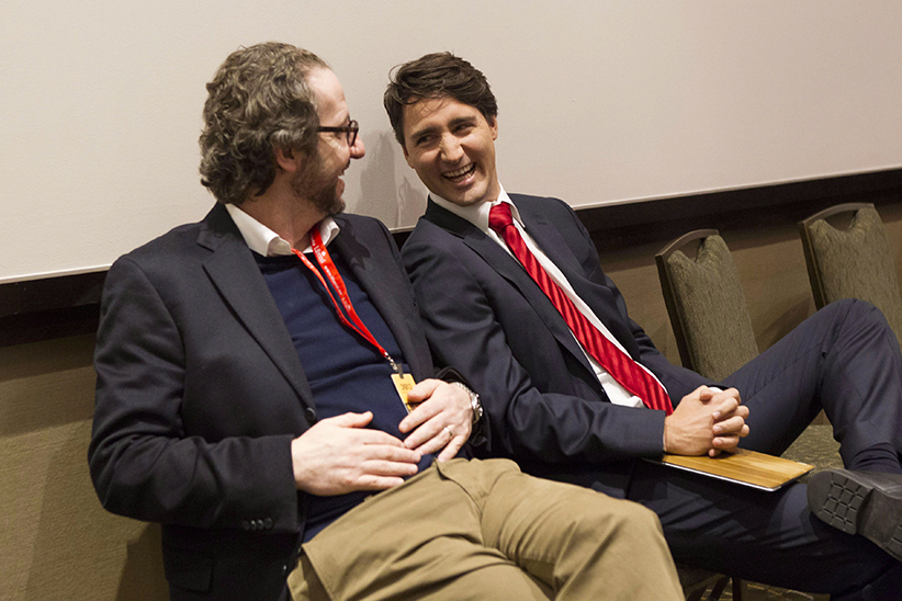 Justin Trudeau, right, chats to his chief advisor Gerald Butts after taking part in the the Liberal leadership debate in Mississauga, Ont., on Saturday, February 16, 2013. (Chris Young/CP)