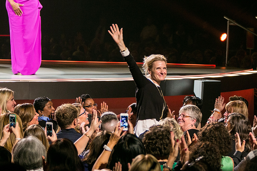 Elizabeth Gilbert waves at the crowd at Oprah's The Life You Want Weekend on November 7, 2014 in Seattle, Washington. (Suzi Pratt/FilmMagic/Getty Images)