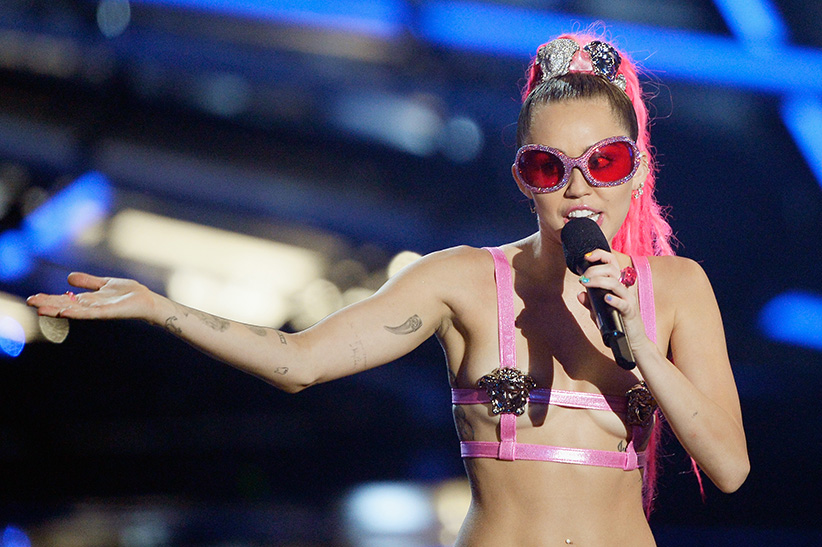 Host Miley Cyrus, styled by Simone Harouche, speaks onstage during the 2015 MTV Video Music Awards at Microsoft Theater on August 30, 2015 in Los Angeles, California. Kevork Djansezian/Getty Images