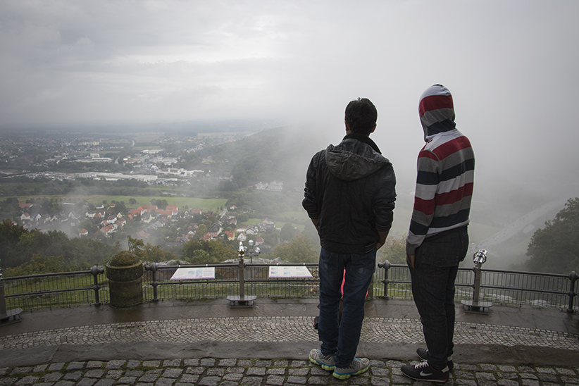 Minden, Germany   Qassim Ali (left) and his friend from the refugee shelter at the power station in Veltheim taken in the view of Minden and Porta Westfalica from the Kaisar Wilhelm monument. (Photograph by Adnan R. Khan)