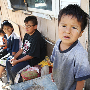 Children outside the trailer of Richard Andrews in Wasagamack First Nation.  It is in filthy condition, has mold and is overpopulated by over 13 people living inside. It has  no running water- See Mary Agnes No Running Water Feature ñ August 18, 2011. (Joe Bryska/Winnipeg Free Press)
